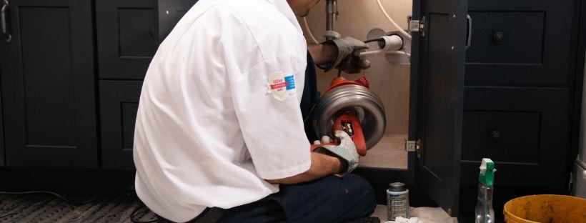 Hiller plumber working on sink