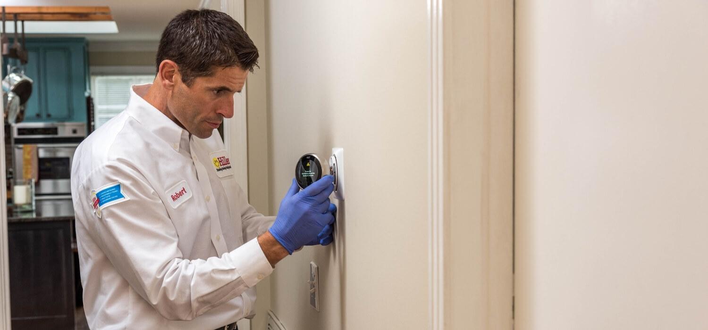 HVAC Technician Fixing Thermostat