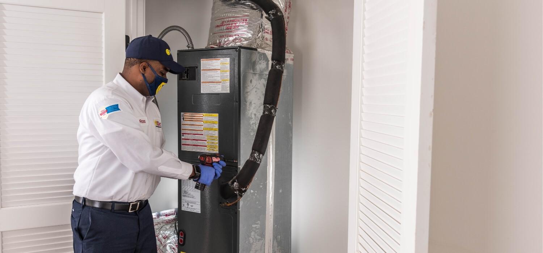 HVAC Technician Completing Furnace Repair