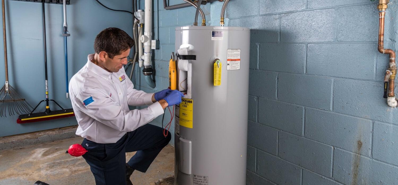 Plumber Fixing Water Heater