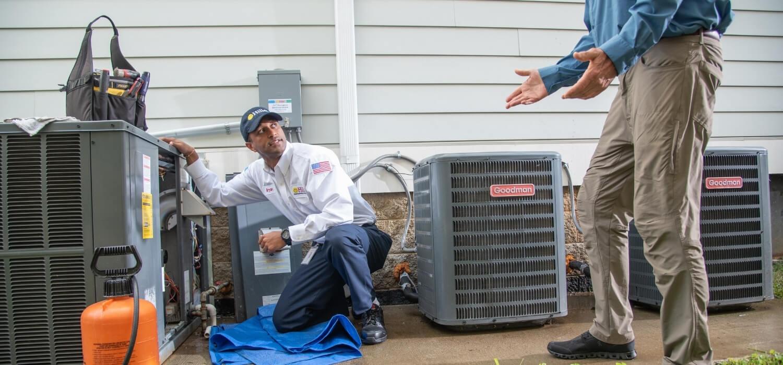 Hiller HVAC Technician Explaining HVAC System to Customer