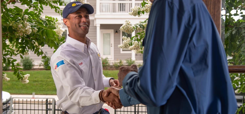 Hiller Professional Plumber Greeting Customer
